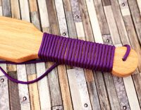 close-up of paracord-wrapped handle of small red oak handle