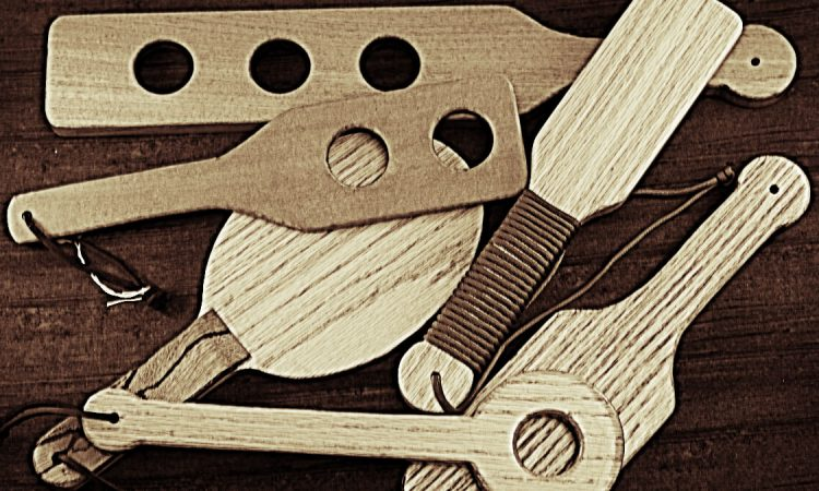 assortment of wooden paddles in sepia tones