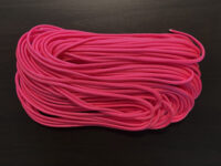 hot pink paracord on dark brown background
