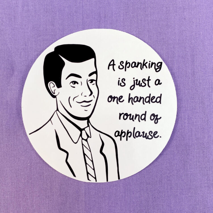 round black and white sticker on purple background. Drawn masculine figure in black, text reads a spanking is a one handed round of applause