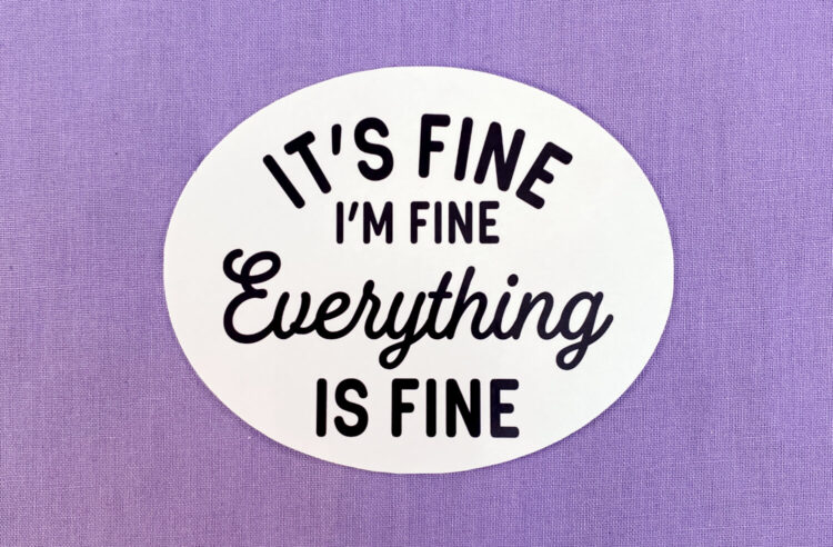white oval sticker with black text on purple background. Black text says it's fine i'm fine everything is fine