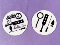 both text and non-text versions of weapons of ass destruction stickers on purple background