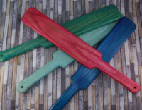 four pop-o-color large paddles in pink, turquoise, aqua, and blue over wooden background