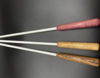 """side view of three 3/8"""" white delrin canes with exotic wood handles; top to bottom: purpleheart, ebony, bocote"""